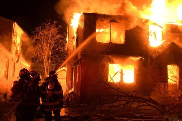 Firefighters battle a house fire on Newton Avenue