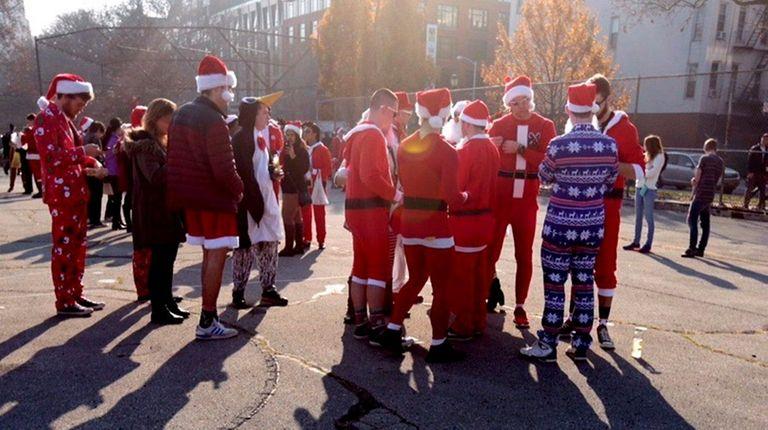 SantaCon participants gather in McCarren Park in Brooklyn