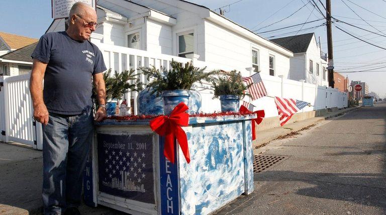 Bill Murphy stands by the 9/11 memorial he
