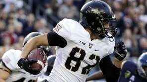 Army wide receiver Edgar Poe rushes during an