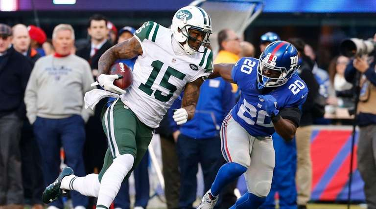 The Jets' Brandon Marshall runs after making a