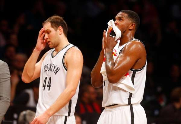 Nets' Bojan Bogdanovic and Joe Johnson take a