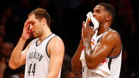 Nets' Bojan Bogdanovic and Joe Johnson take a