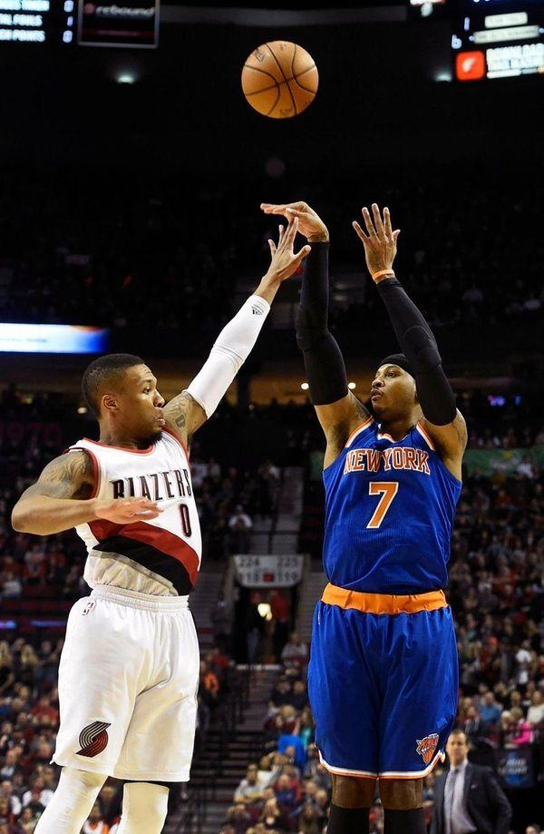 Knicks forward Carmelo Anthony shoots over Trail Blazers