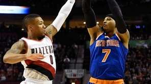 Knicks forward Carmelo Anthony shoots over Trail Blazers