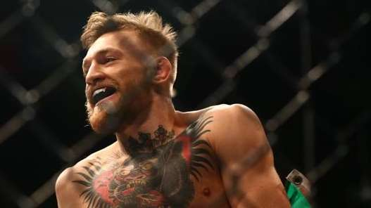 Conor McGregor celebrates his 13-second knockout of Jose