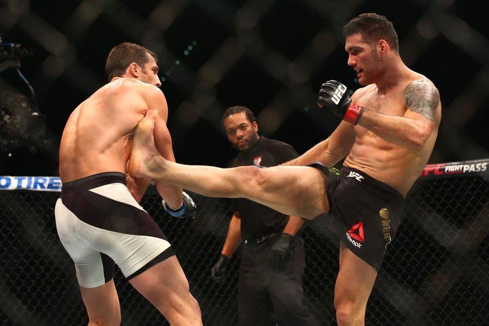 Chris Weidman goes for the kick on Luke