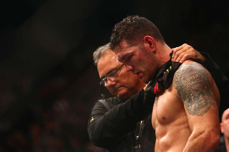 Chris Weidman is consoled by his father, Charlie