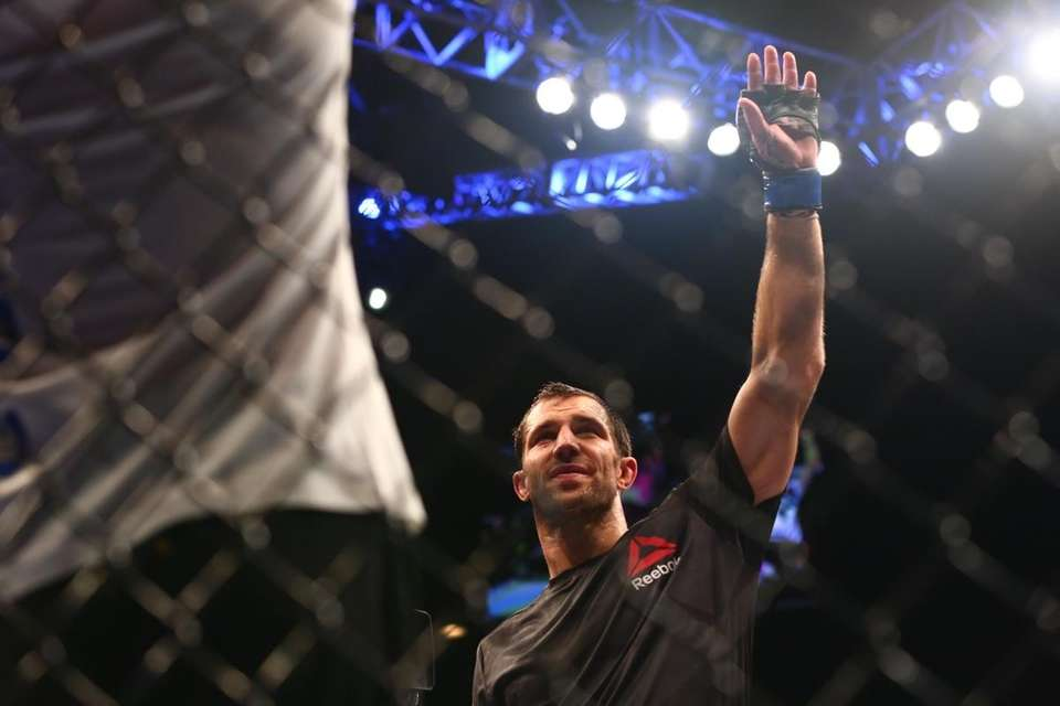 Luke Rockhold waves to the crowd after beating
