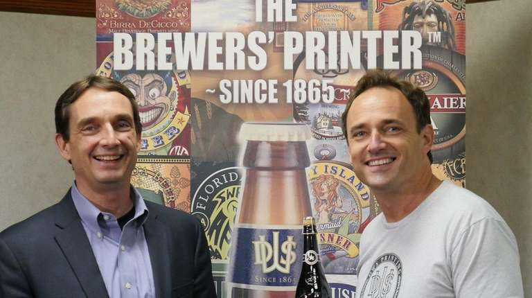 Andrew Staib holds the special Brooklyn Brewery