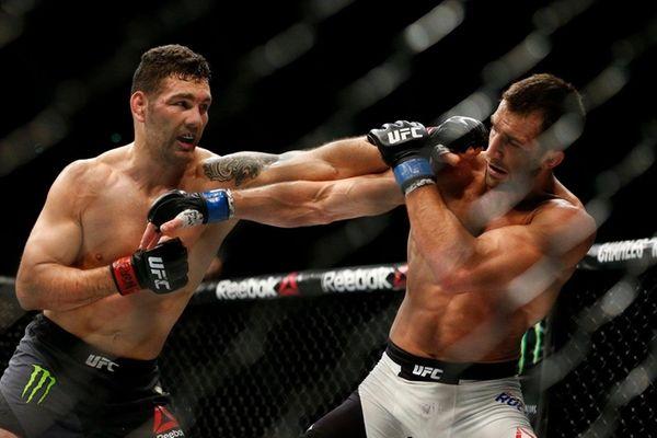 Chris Weidman, left, fights Luke Rockhold in