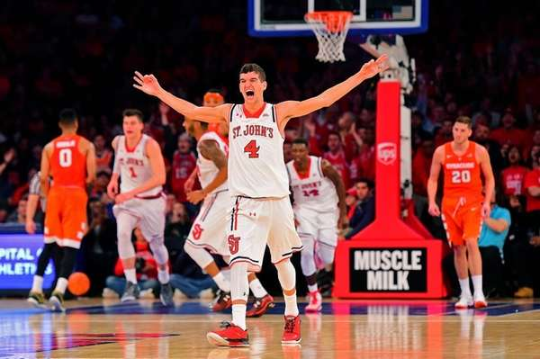 St. John's guard Federico Mussini (4) reacts after