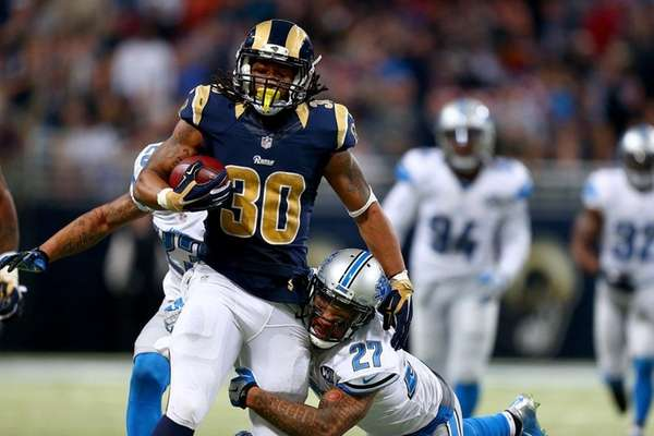 Glover Quin tries to tackle Todd Gurley