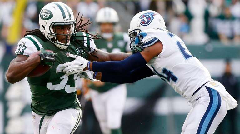 Chris Ivory carries the ball in the first