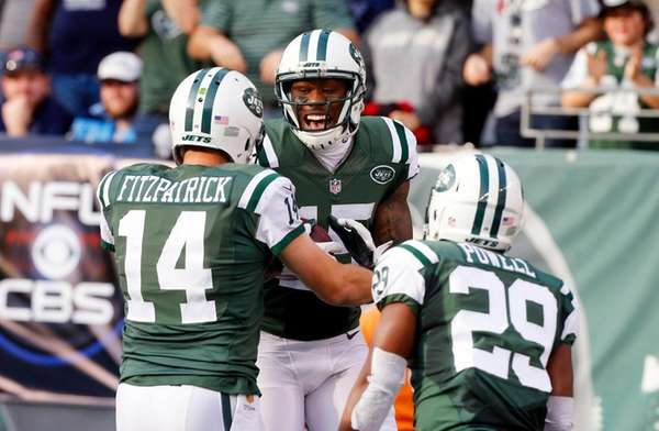 Jets' Brandon Marshall, center, celebrates 69-yard touchdown reception
