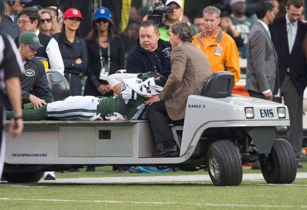 Jets receiver Devin Smith is carted off the