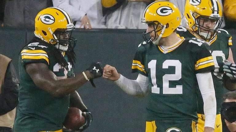 Green Bay Packers' Eddie Lacy is congratulated