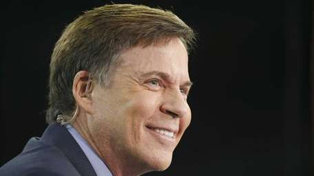 Television announcer Bob Costas watches the Houston Texans