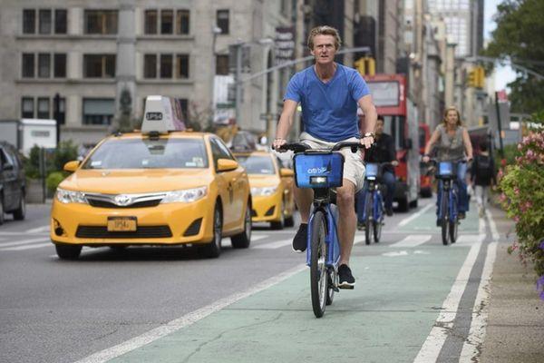 Bicyclists ride on a bike lane on Broadway
