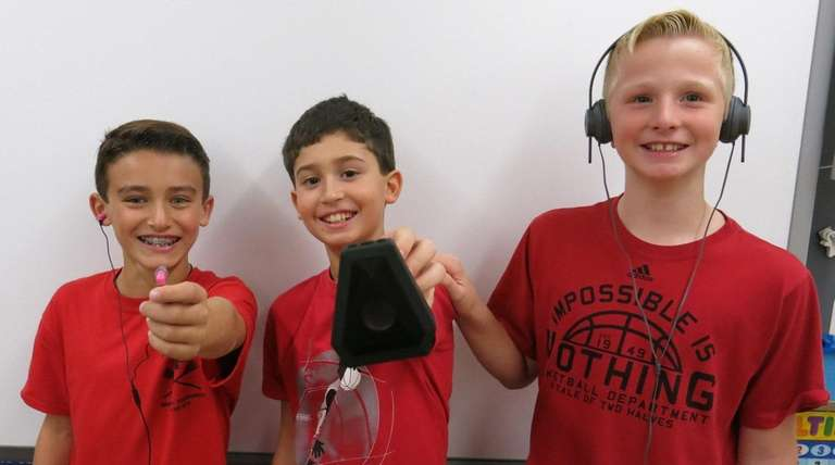 Kidsday reporters Brayden Fitzpatrick, left, William Carmenaty and