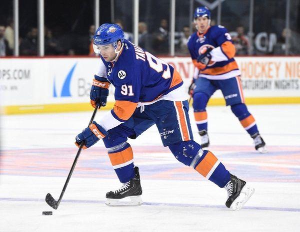Islanders center John Tavares skates with the puck
