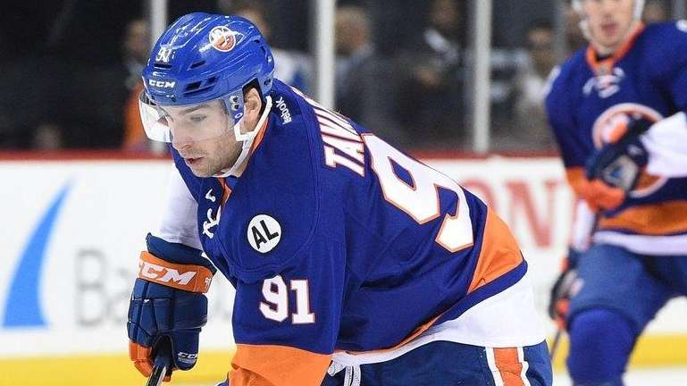 Islanders center John Tavares skates with the puck