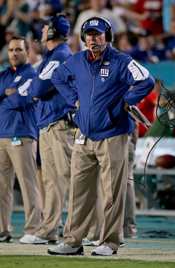 Giants coach Tom Coughlin took a big hit