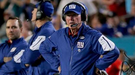 Giants coach Tom Coughlin took a big hit
