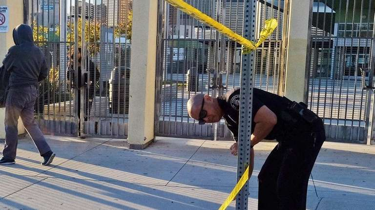 A police officer puts up yellow tape
