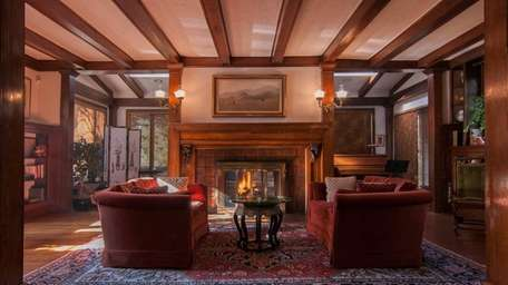 One of four fireplaces in a Woodmere house