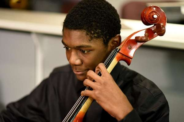 Amari Dechinea, 16, of Uniondale, plays the cello