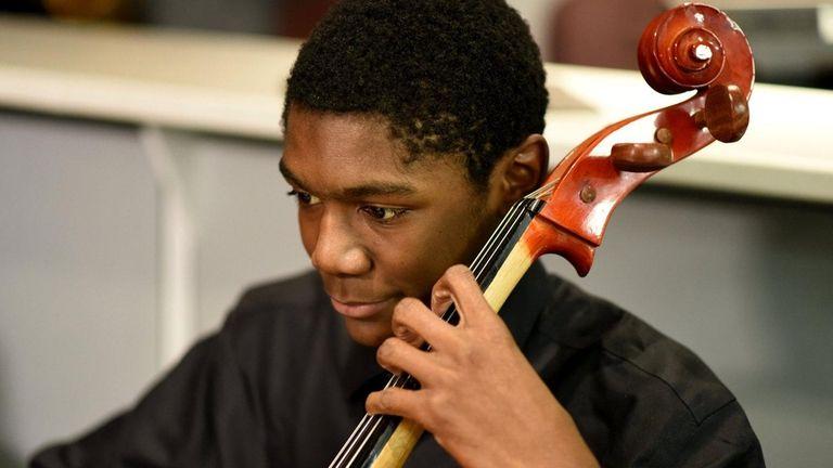 Amari Dechinea, 16, of Uniondale, plays the cello