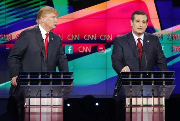 Ted Cruz, right, speaks as Donald Trump looks