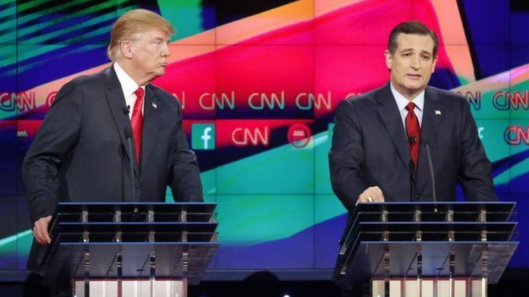 Ted Cruz, right, speaks as Donald Trump looks