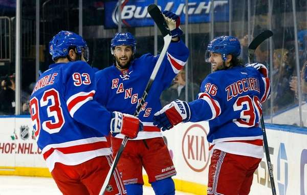 Mats Zuccarello, right, of the Rangers celebrates his