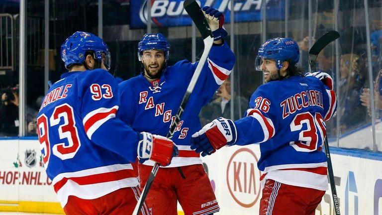 Mats Zuccarello, right, of the Rangers celebrates his