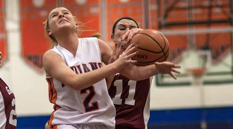 Manhasset's Erin Barry (2) drives during a game