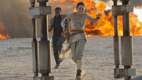 John Boyega as Finn and Daisy Ridley as