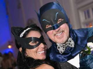 Batman and Catwoman at their wedding reception.