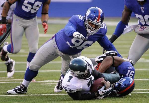 Philadelphia Eagles quarterback Michael Vick, center, is