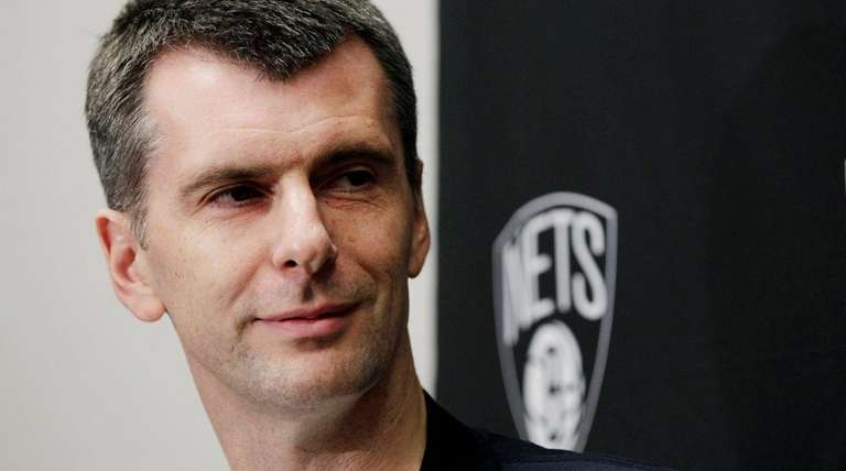 Brooklyn Nets owner Mikhail Prokhorov pauses during a