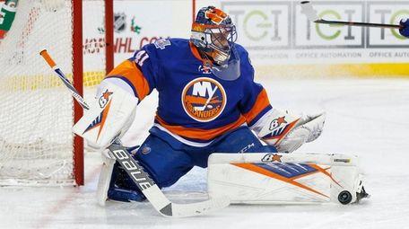Jaroslav Halak of the New York Islanders makes
