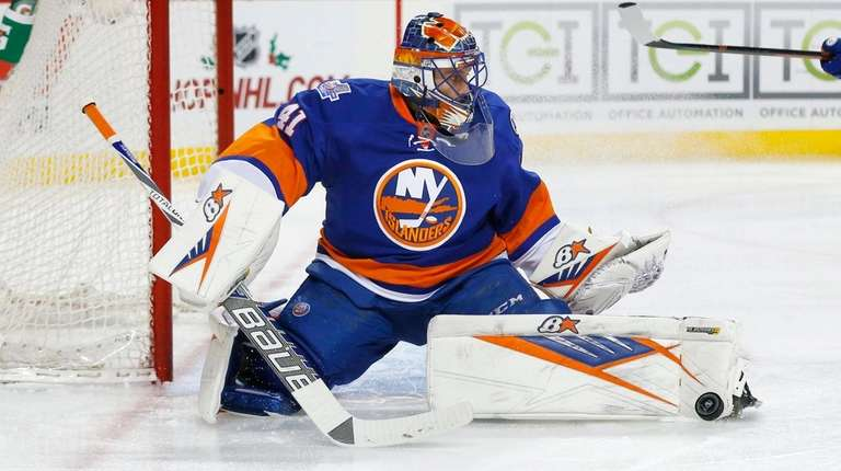 Jaroslav Halak of the New York Islanders makes