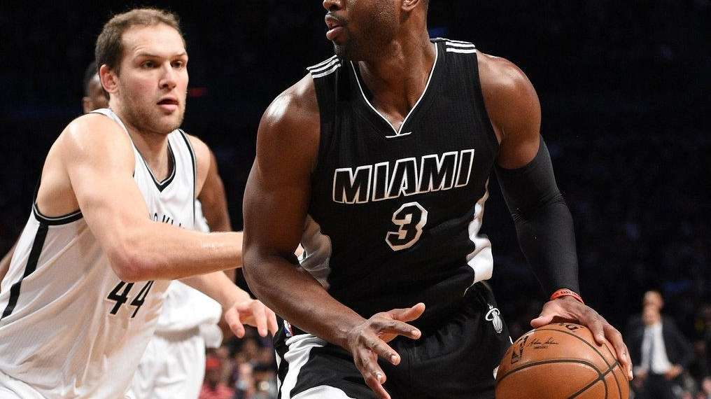Miami Heat guard Dwyane Wade controls the ball