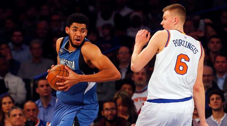 Kristaps Porzingis of the Knicks defends against fellow
