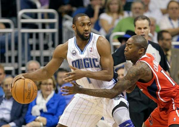 Orlando Magic's Gilbert Arenas, left, looks for