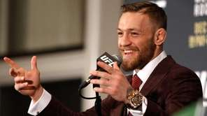Conor McGregor speaks at a post-fight press conference