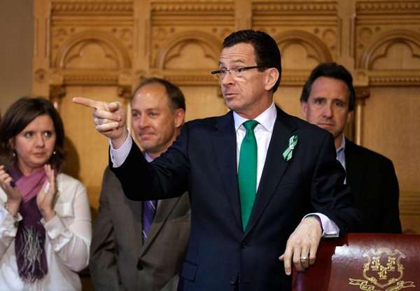 Connecticut Gov. Dannel P. Malloy, second from right,
