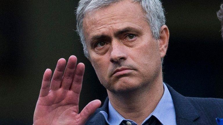 Chelsea head coach Jose Mourinho waves at
