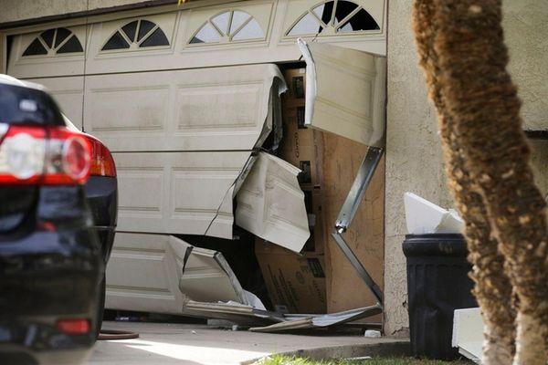 A garage door of Enrique Marquez's home